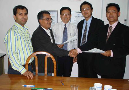 Contract signing and exchanging the Documents, Former Service Division Manager Mr Laxmsn Devekota and Mr K Namgay, Chhuka Plant Manager